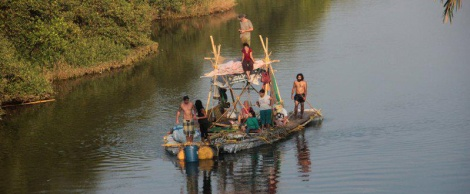 The 2013 recicling raft Saly travels with the tidal current up and down river Sal in Goa, India